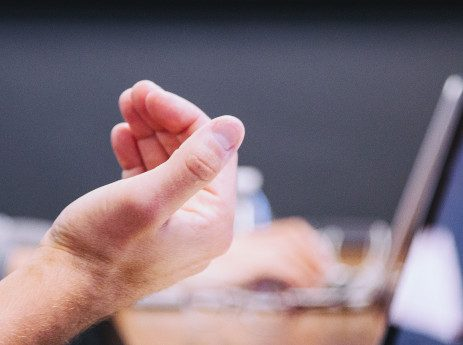 man gesturing during a business meeting