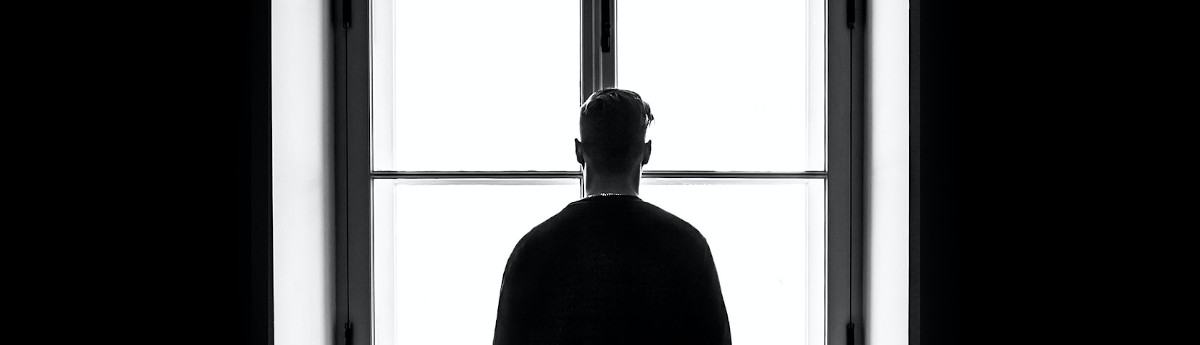 man looking out of the window away from camera