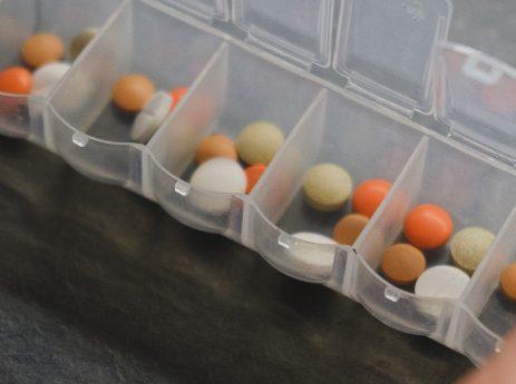 medication organizer full of multiple types of pills