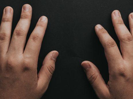 hands on dark background